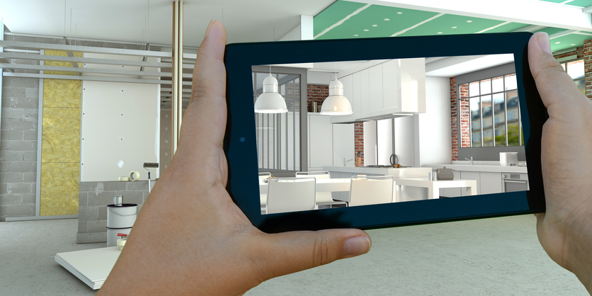 A room's final design is visualized utilizing BIM software on an iPad