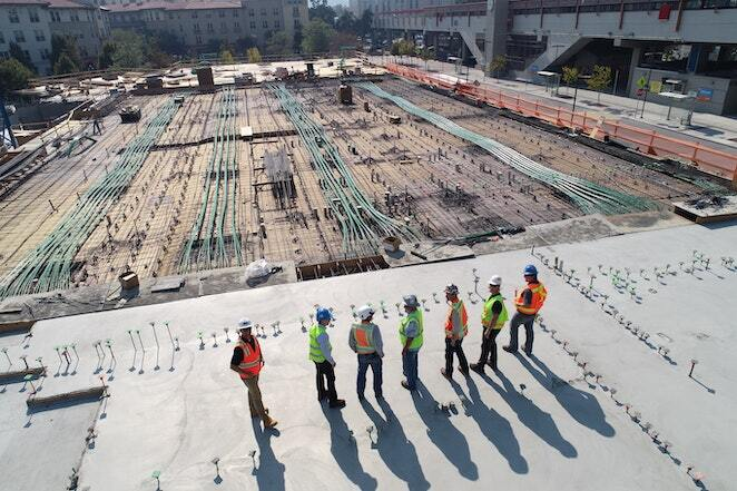 7 construction workers gather on jobsite