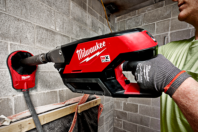 Milwaukee MX FUEL core drill safely cores through a concrete wall