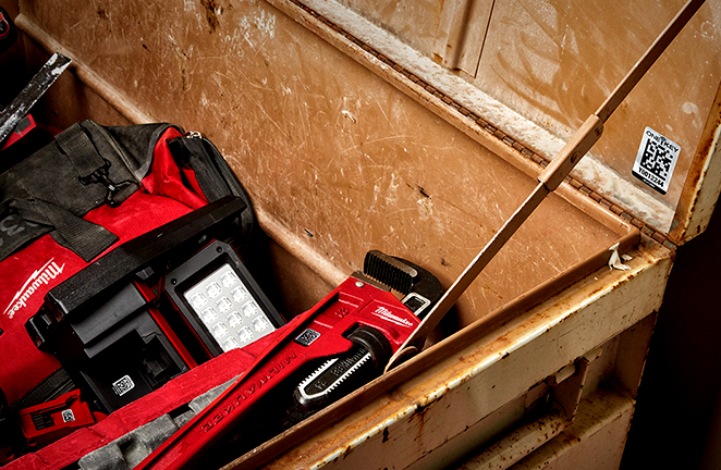 a job box is full of wrenches, lights, and other items that are marked with asset id tags