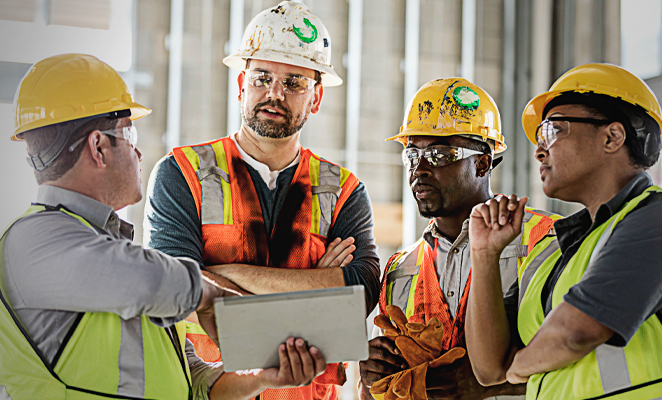 A construction project management team confers together