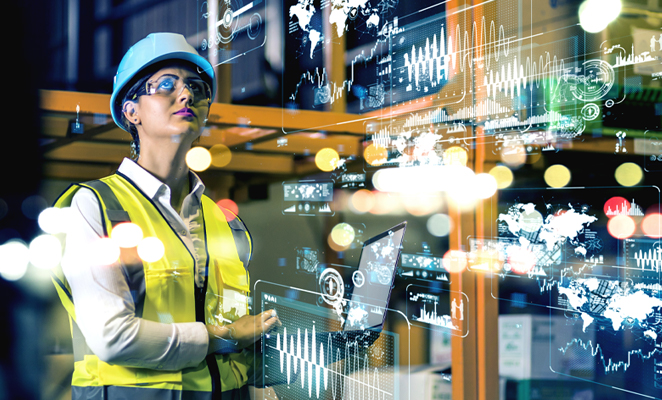 Photo shows construction woman with laptop computer illuminated by data overlay