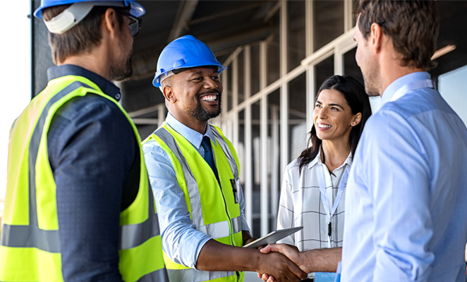 Two contractors meet two clients, shaking hands