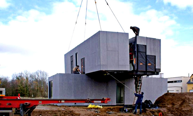 Construction worker oversees installation of prefabricated modules