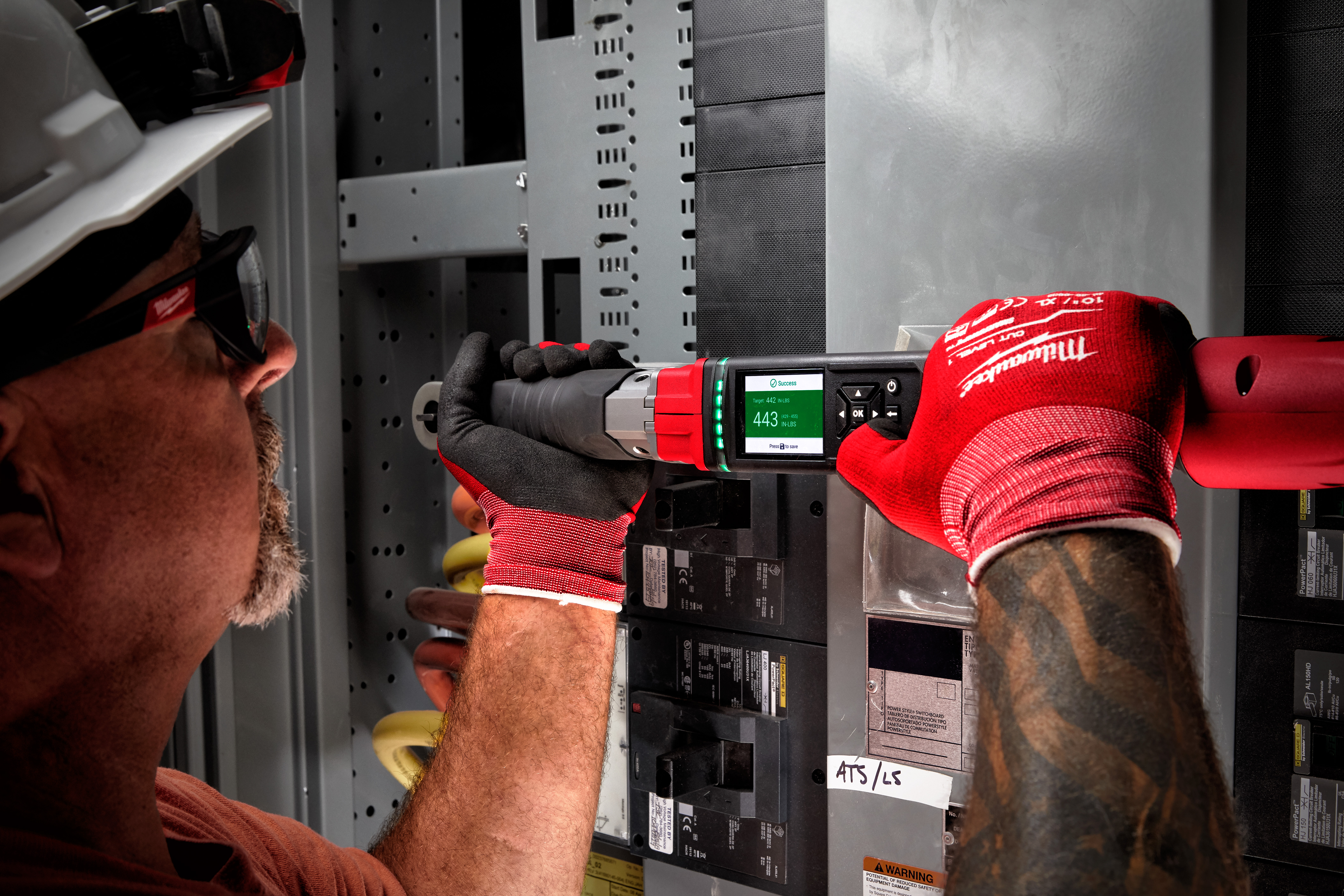 An electrical contractor uses a Milwaukee digital torque wrench to complete installation