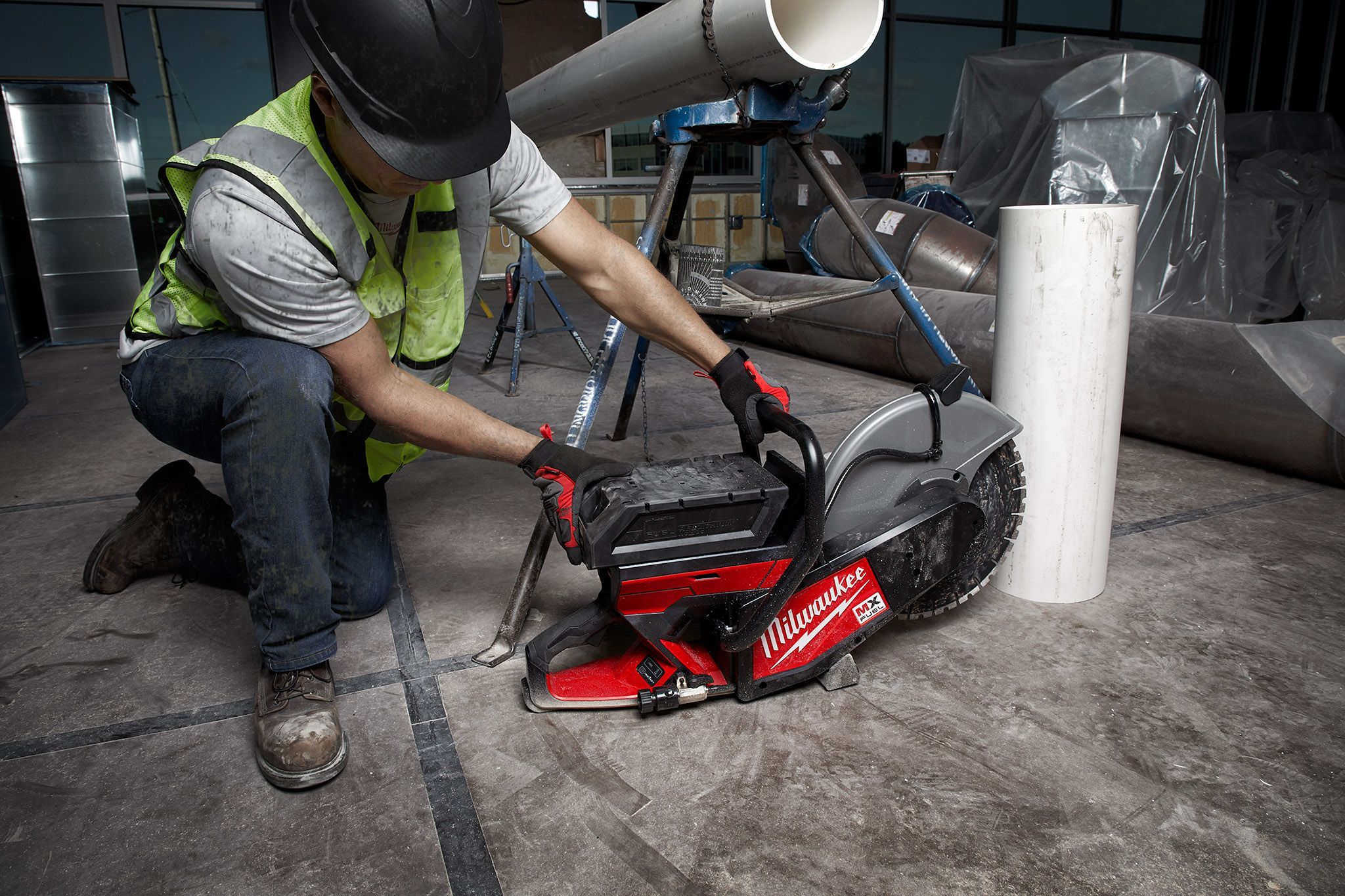 A concrete finisher uses MX FUEL Cut Off Saw to cut out section in floor