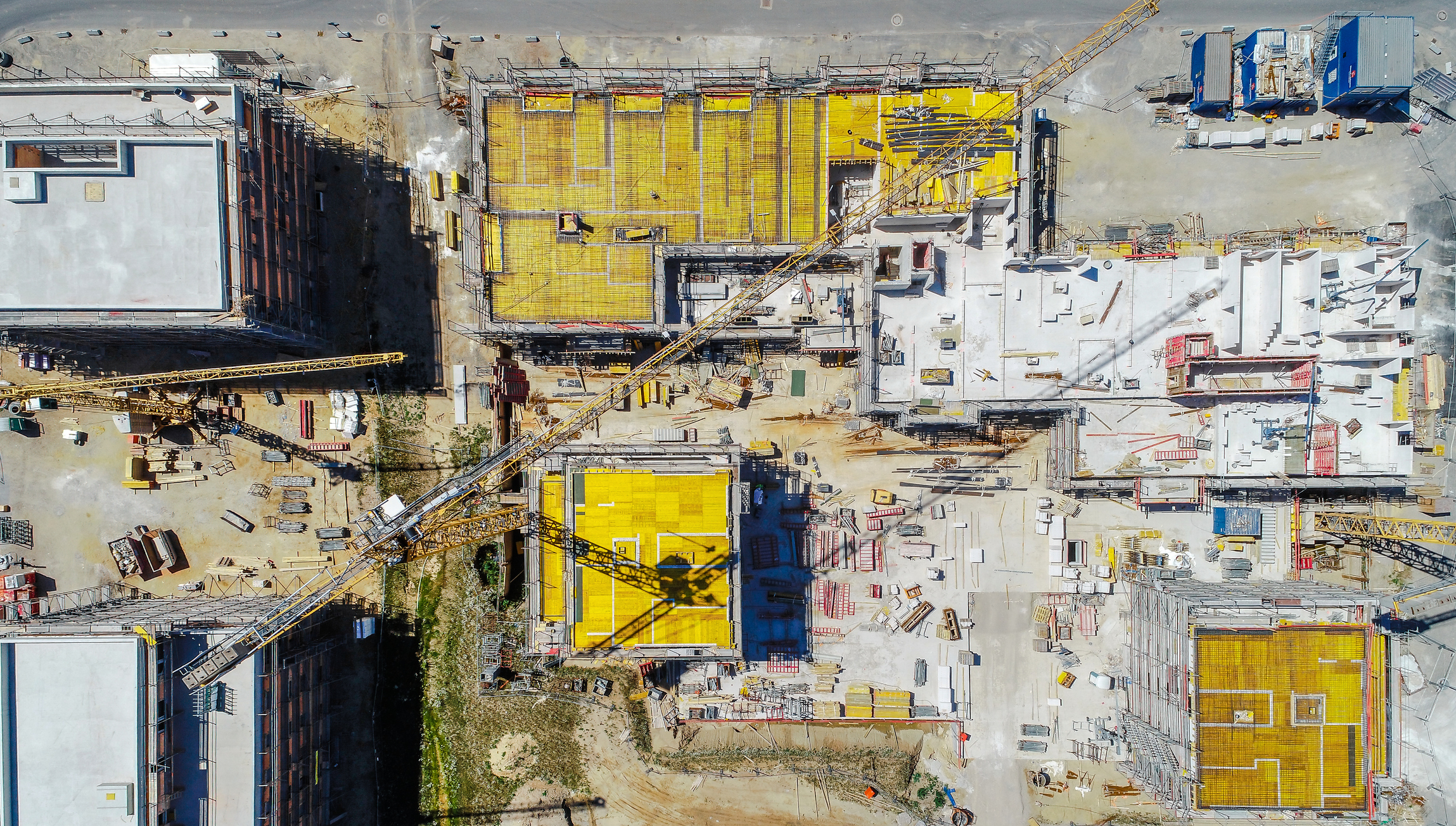 An arial shot of a construction site taken from a drone from overhead