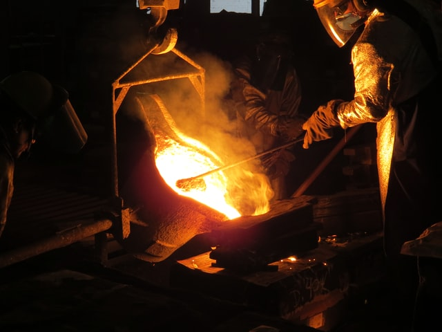 A blacksmith forges tool in fire