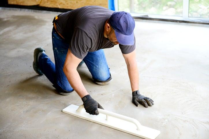 A contractor installs a cement floor