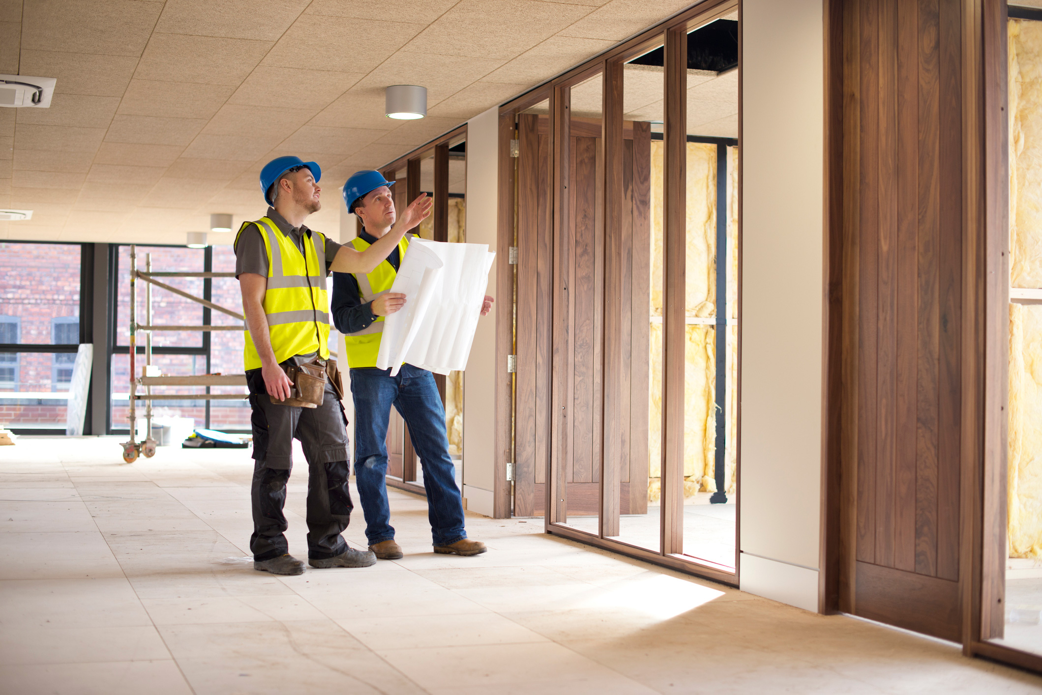 Two construction and building inspectors examine jobsite