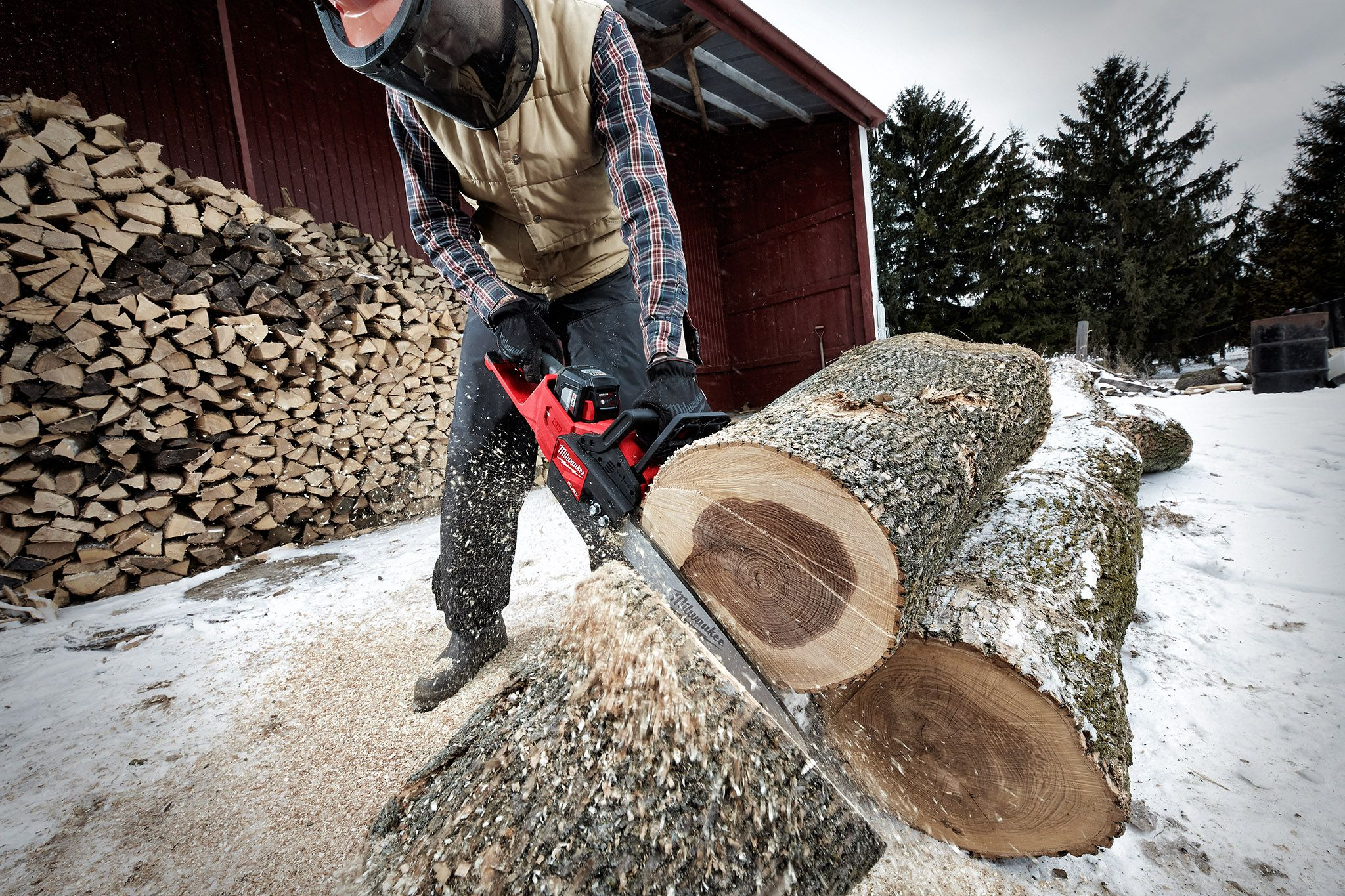 A Milwaukee battery-powered chainsaw used to cut down a tree
