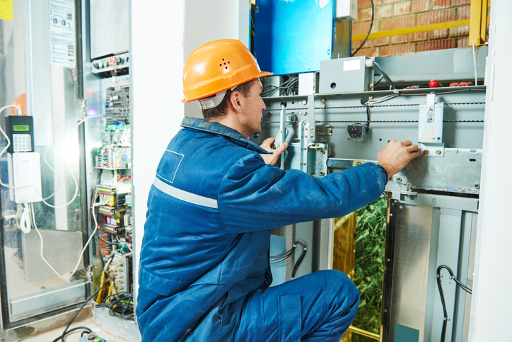 An electrician services elevator