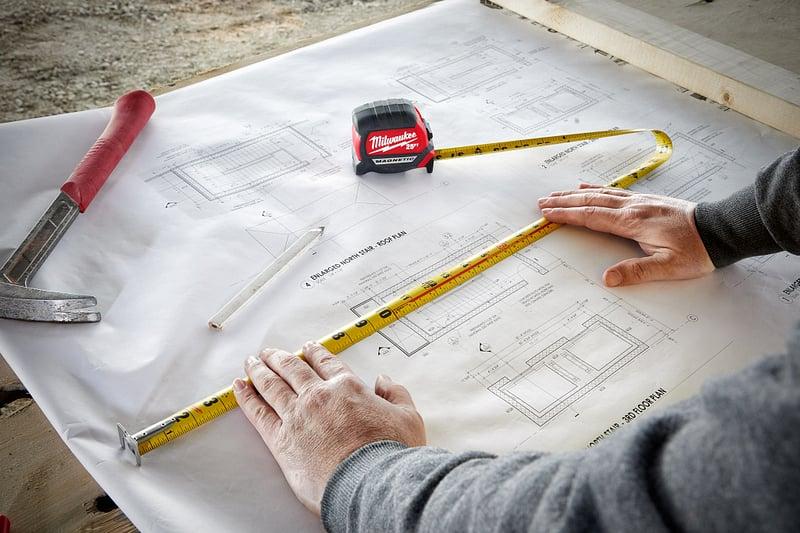 general-contractor-tape-measure-blueprints