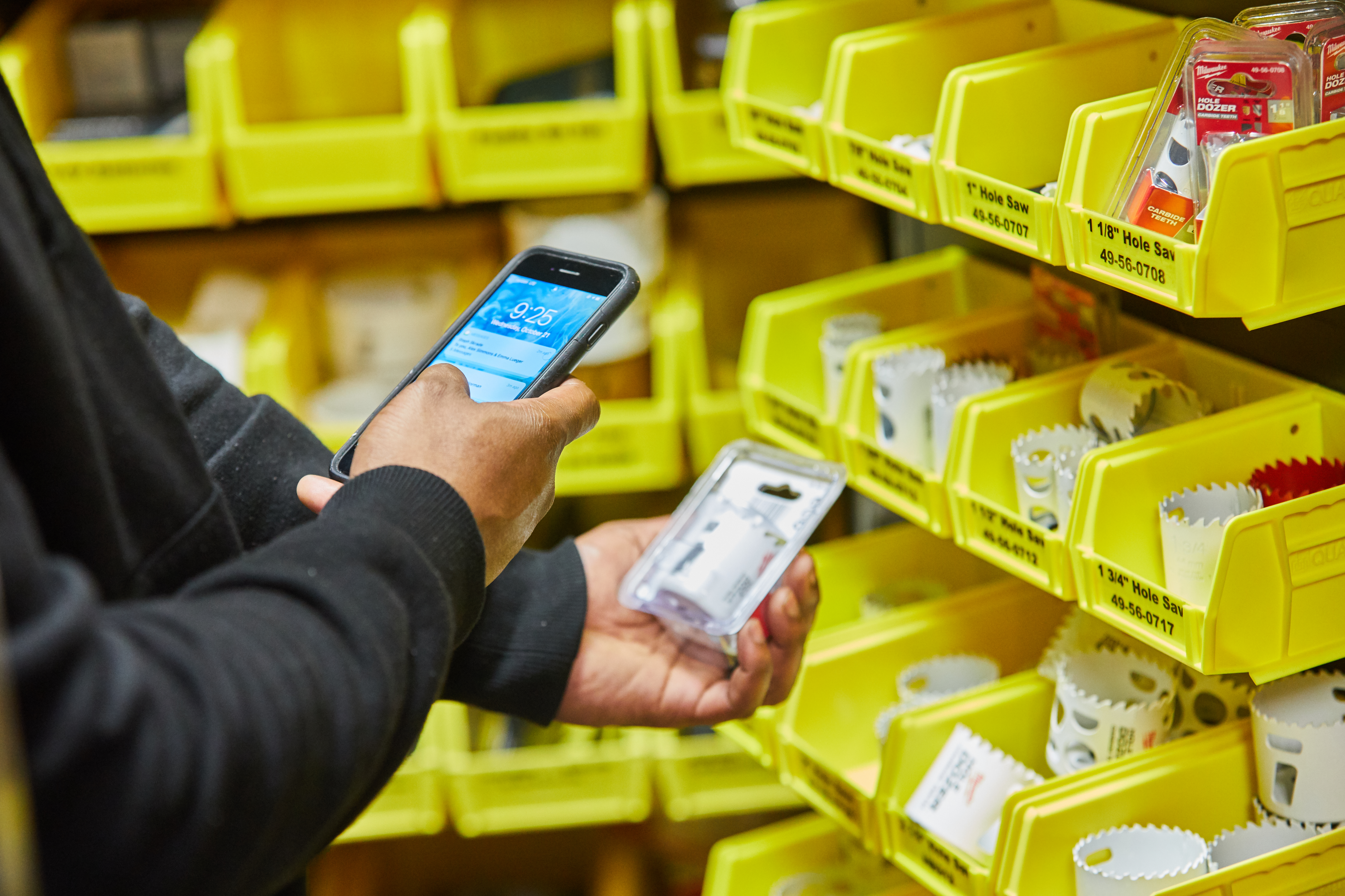 An inventory manager checks in item using mobile device