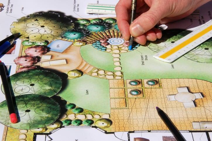 A landscape architect plots out design