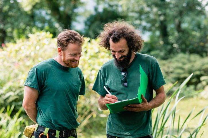 landscape discuss plans in green clipboard