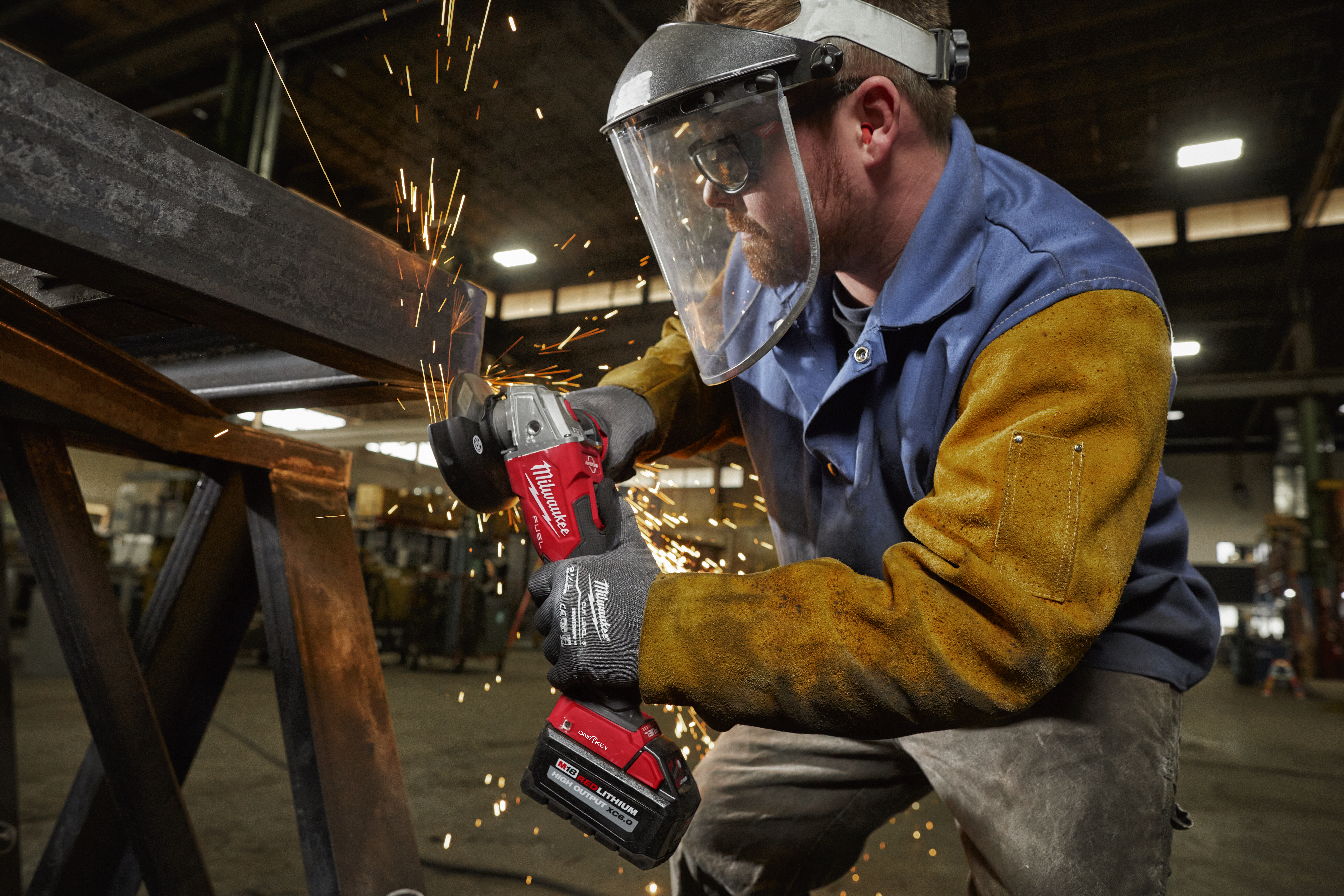 A metalworker utilizes a Milwaukee grinder that is compatible with the One-Key app