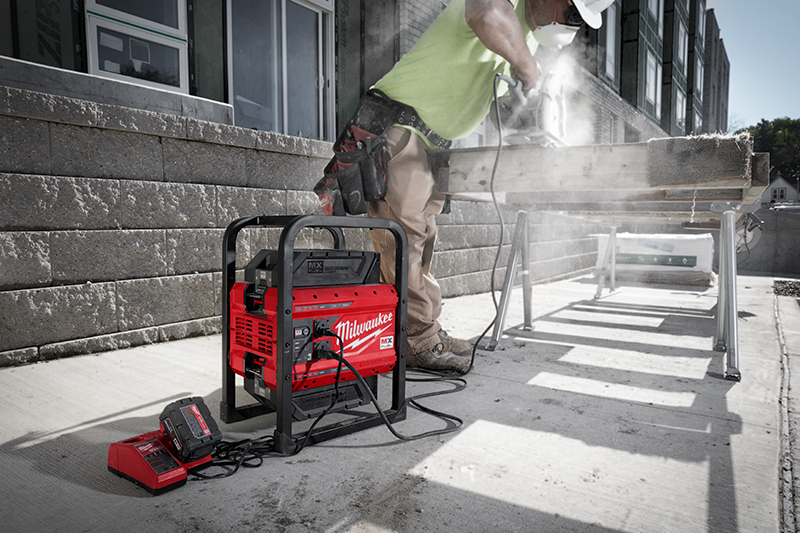 MX FUEL™ battery-powered CARRY-ON™ power supply powers contractor's circ saw and M18™ charger beside it