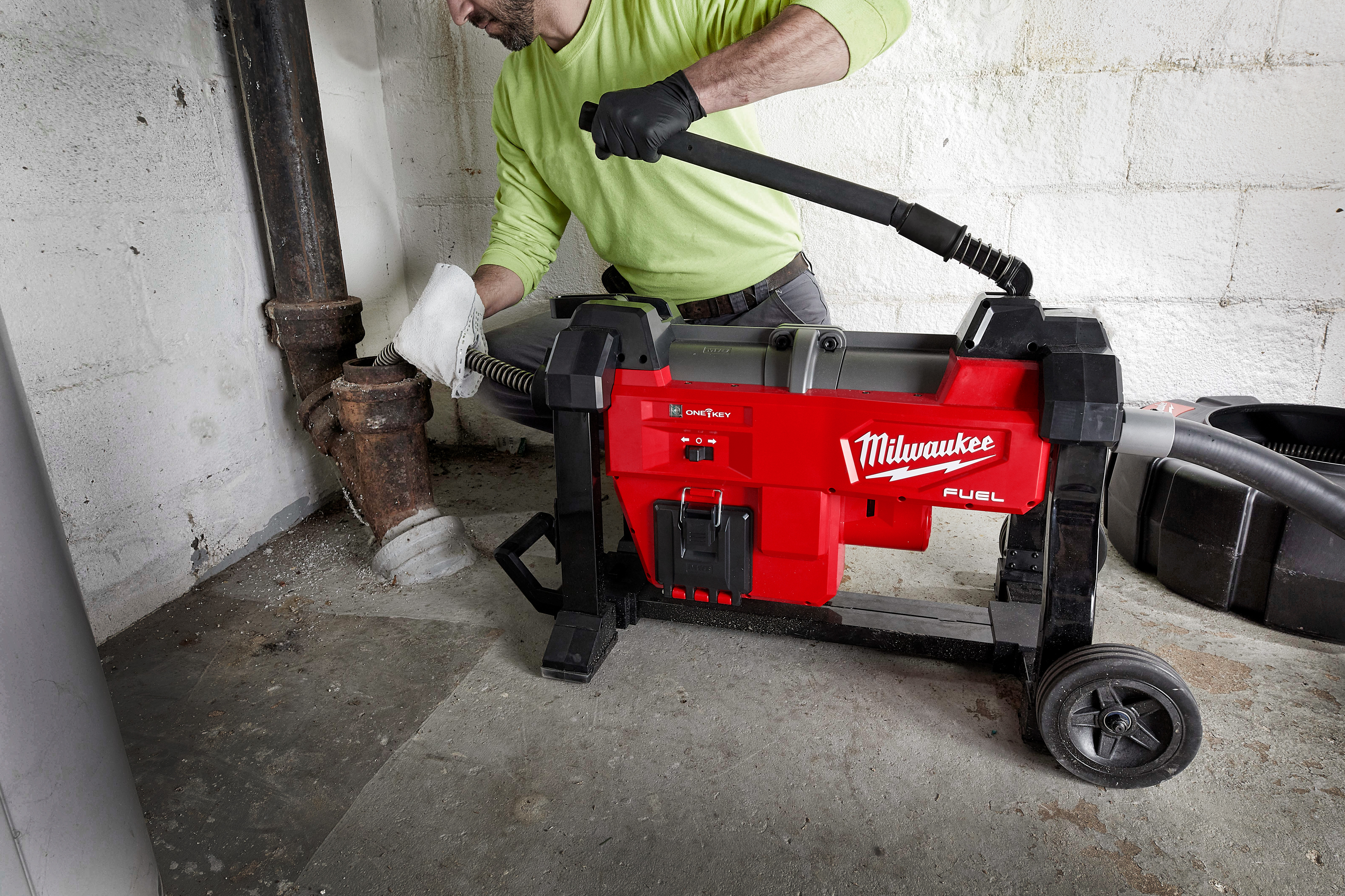 A drain cleaning professional utilizes a Milwaukee sectional drain cleaning machine