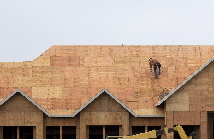 A roofer prepares roof for shingle installation