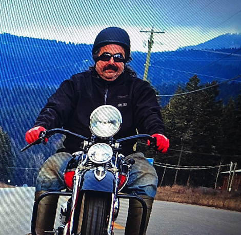 Rust Valley Restorers Avery Shoaf riding a vintage Harley-Davidson motorcycle wears a Milwaukee TOUGHSHELL heated jacket