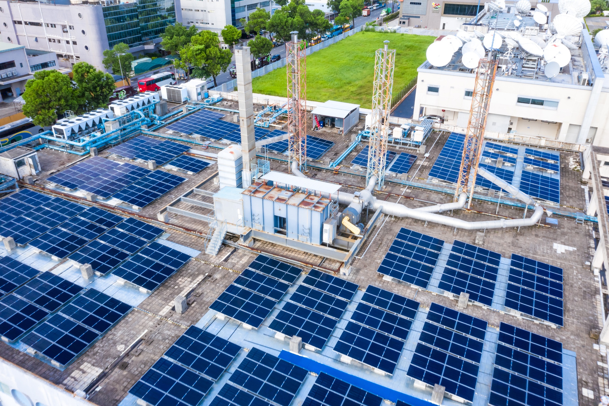 An areal shot of a warehouse rooftop utilizing solar panels for power