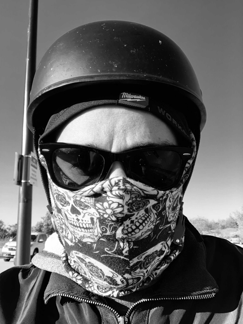 A WORKSKIN hardhat liner worn under a 1/2 motorcycle helmet