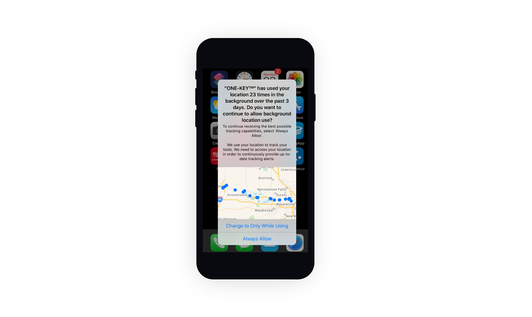 A mobile phone displays a system prompt about background location use