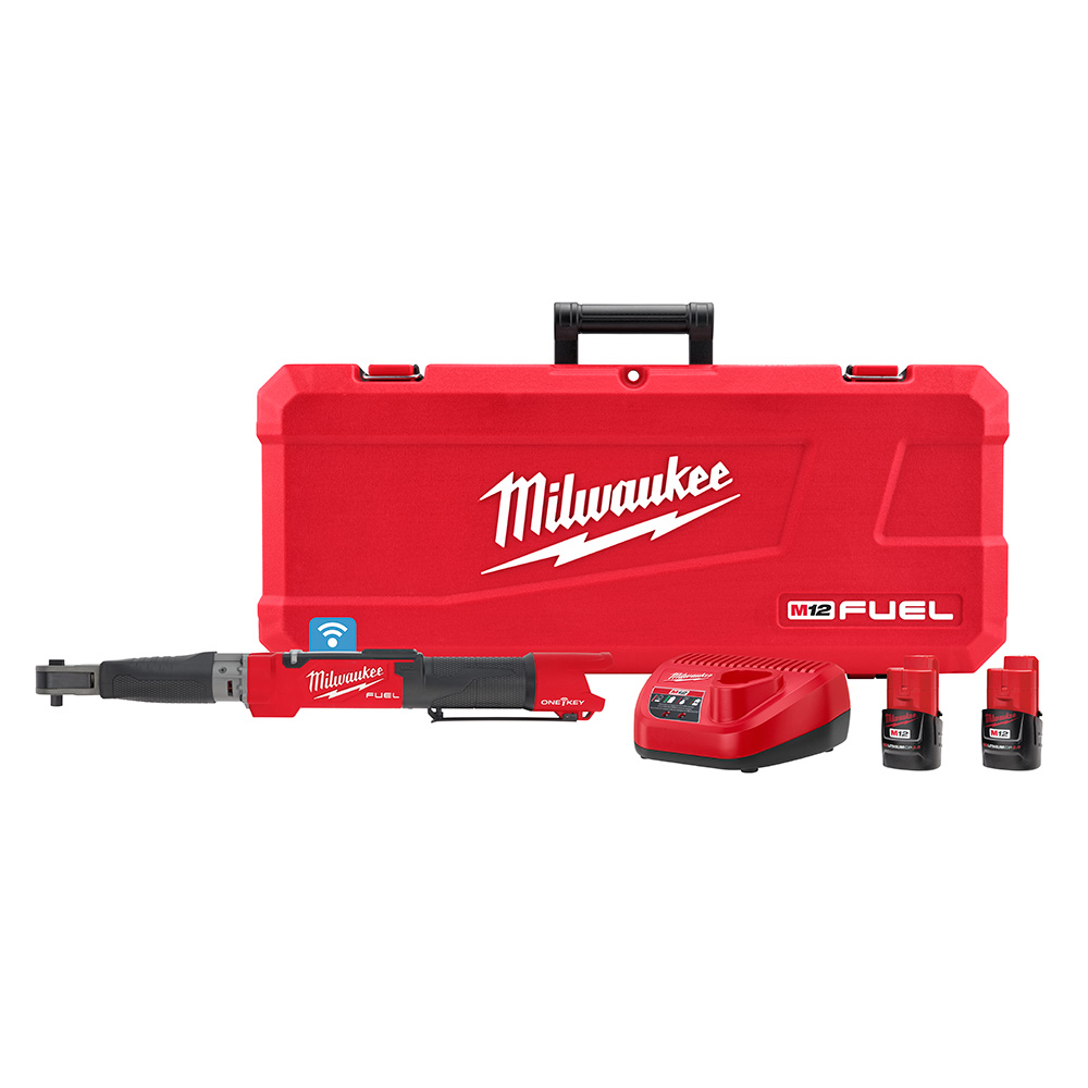 A motorized torque wrench with two batteries and a charger