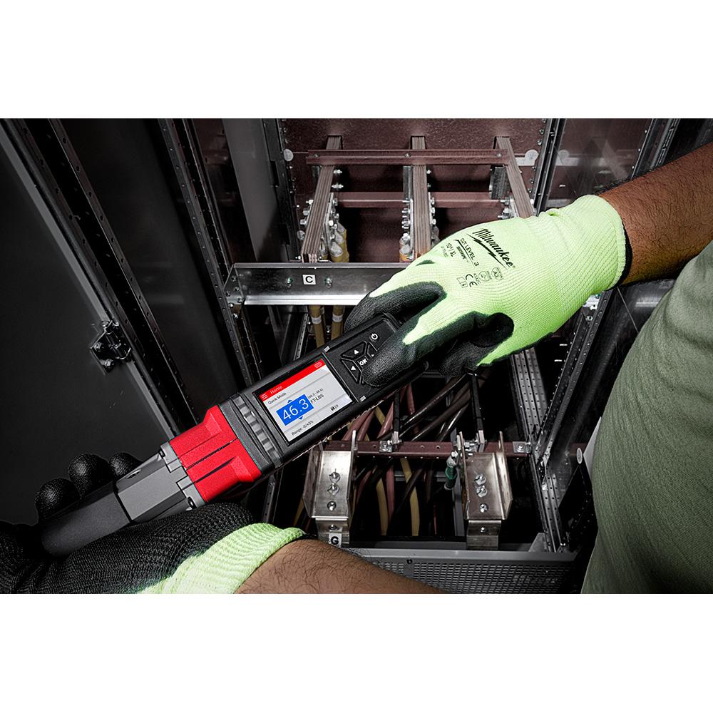 A tradesman configures settings on his Milwaukee digital torque wrench