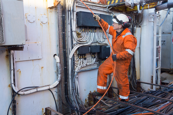 An electrician works on an oil rig
